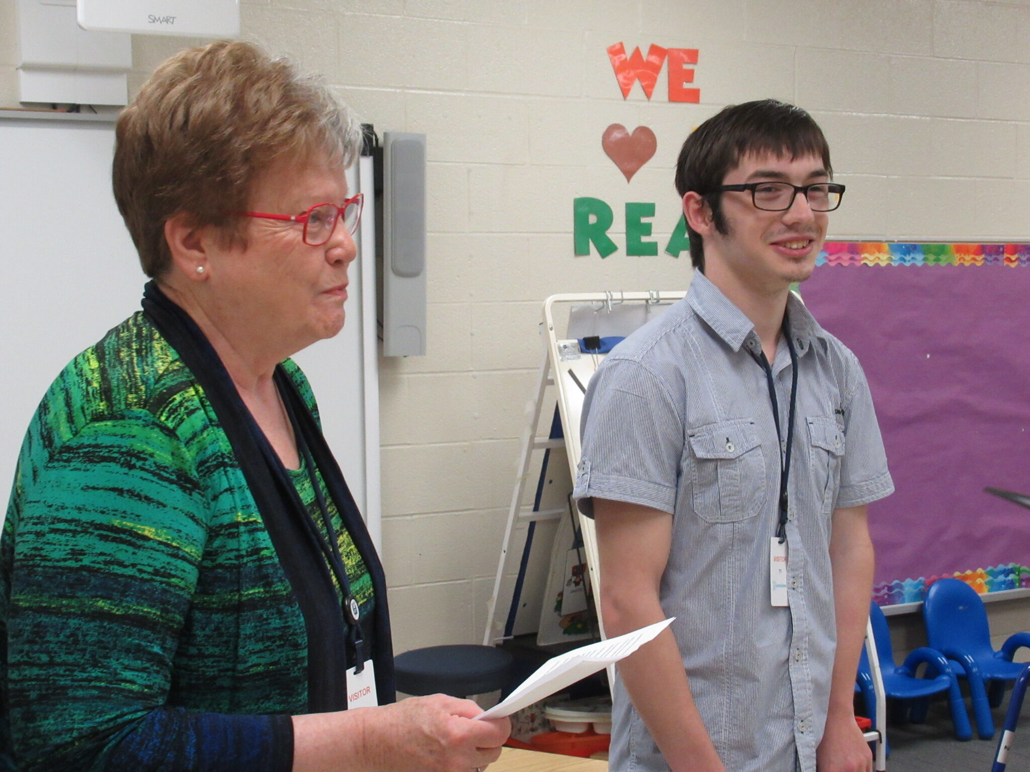 Sam smiles as Ruth presents award