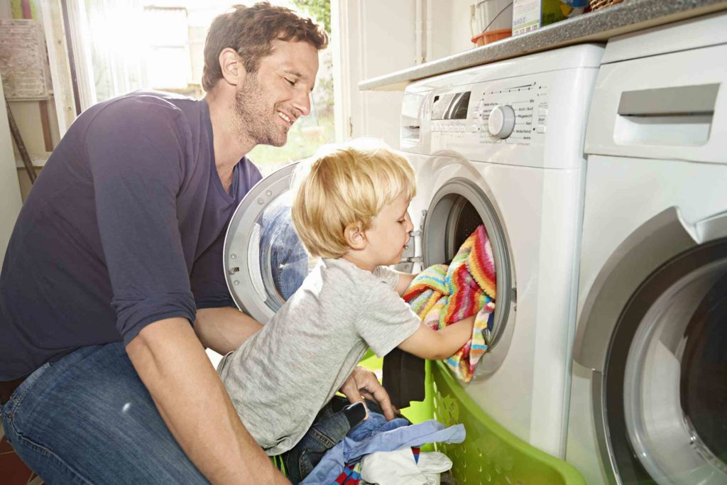 Father and child doing laundry