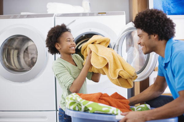 Father and Daughter doing laundry
