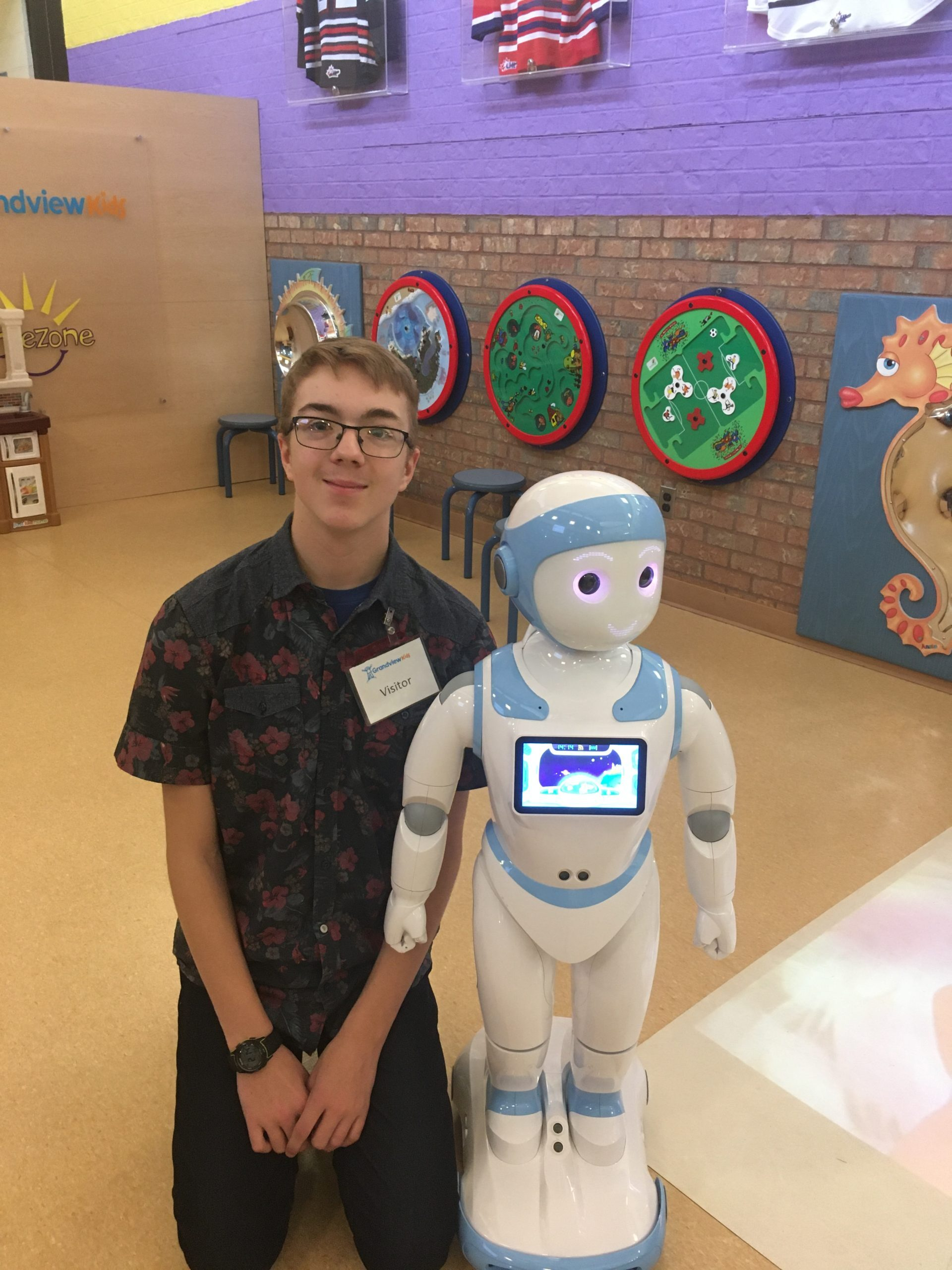 Joy the robot posing with Ethan at Grandview