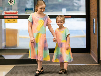Grandview kids sisters, teagan and logan, walking into the centre