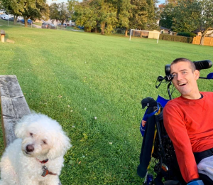Marshall Hohmann, Ability Awareness Presenter and Grandview Grad, posing with his dog, Buddy.